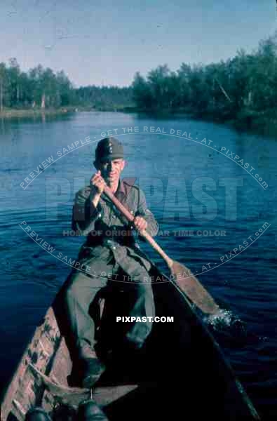 134th Gebirgsjäger, Finland 1944, german soldier in boat on river.