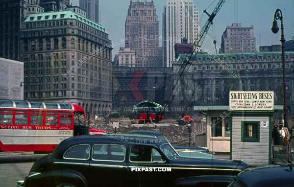 1947 New York City sky scrapers building site bus car cranes