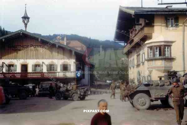 American armoured cars of the 101st Cavalry Regiment park opposite SS troops in Kossen Austria 1945.