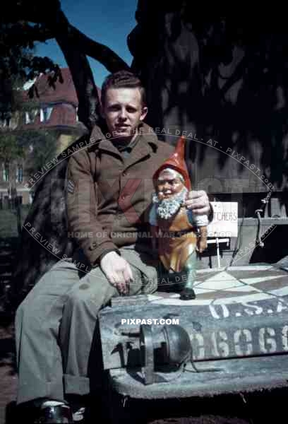 American soldier with german garden gnome. SS Childrens School in Buchenwald Germany 1945.
