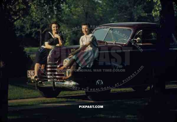 Beautiful women sit on classic car with OHIO plates USA 1940 21-XG-OHIO-1940