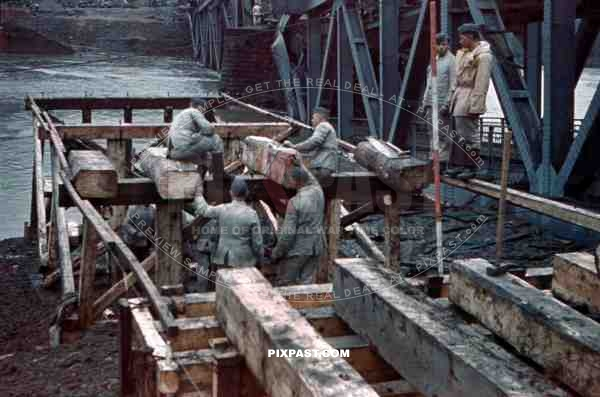 construction of a wooden bridge next to a broken rail bridge near Belgrade, Serbia ~1941