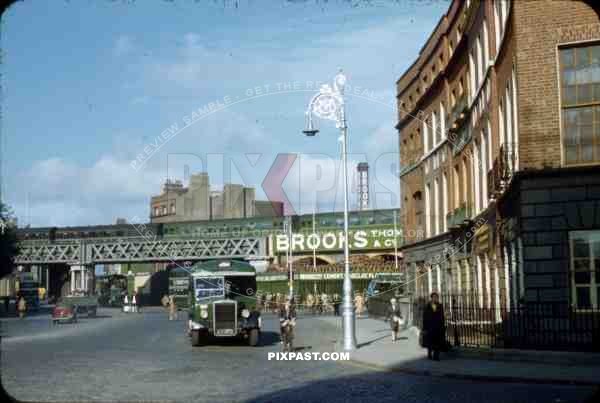Corner of Store Street and Beresford Place, Dublin, Ireland, 1953, Green Bus, old cars, Dart Station, train