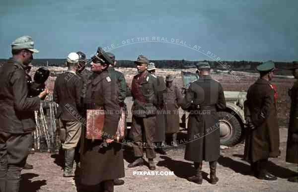 Erwin Rommel standing beside Horch 901 Staff car after Propaganda Film Interview, Tunisia. 1942. General Staff.
