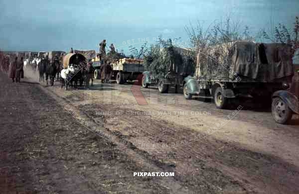 German army supply trucks retreat beside Romanian infantry unit, Russian Front 1944