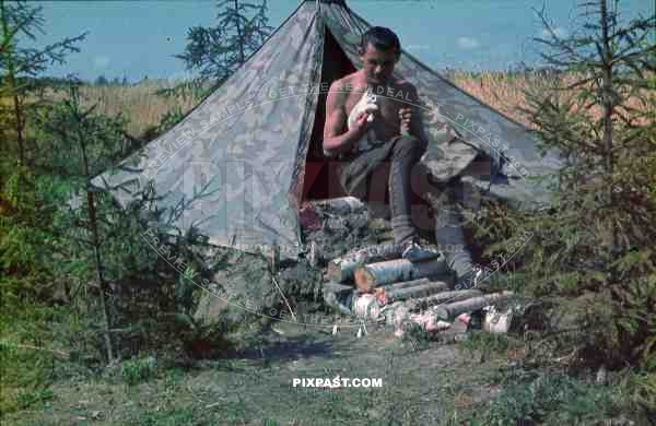 German Luftwaffe FLAK soldier cleaning tent Zeltbahn field russia summer 1941 3. Flak Abt. 701 & German Luftwaffe FLAK soldier cleaning tent Zeltbahn field russia ...