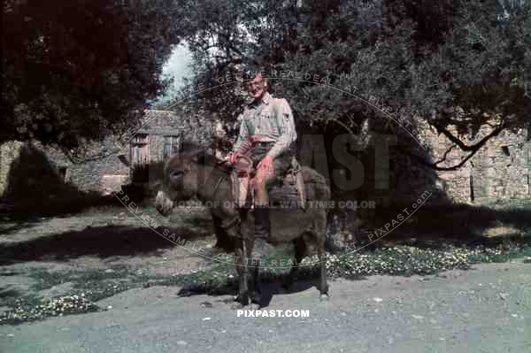 German Luftwaffe flak soldier riding donkey in Village, Kreta Crete 1942.