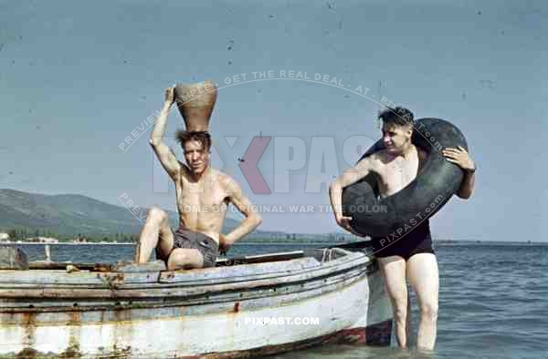 German soldiers infantry shorts swimming play joke funny pot boat beach sea Greece 1942