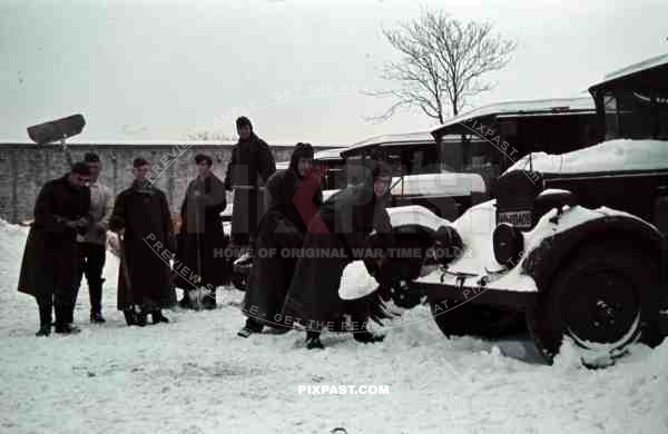 German soldiers Norway 1941 supply trucks lorries snow cleaning shovel winter jackets