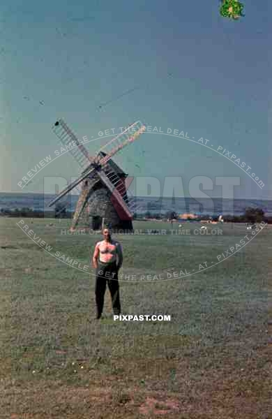 German Wehrmacht soldier topless naked Holland windmill summer 1940