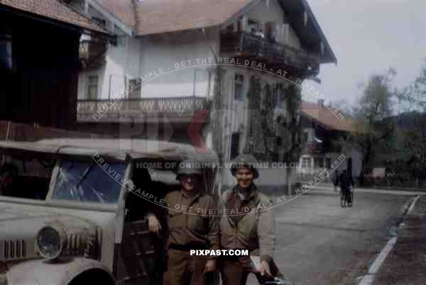 GIs of the 101st Cavalry Regiment in Ruhpolding Bavaria 1945 with captured sand camo Stoewer Typ 40