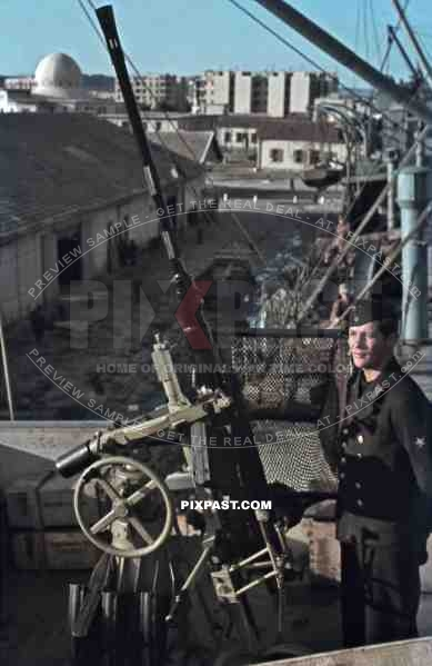 Kriegsmarine sailor beside 20mm Flak AA cannon on german supply ship, Tunis, Tunisia 1942, Quai Transatlantique