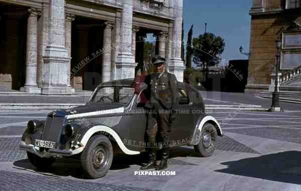 Luftwaffe flak officer of the Leichte Flak Abteilung 99 (mot) in Rome Italy 1944 with staff car.