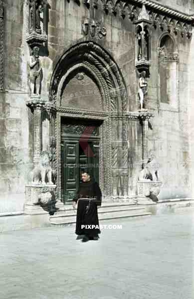 monk in front of St. James cathedral in Sibenik, Croatia