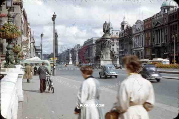O'Connell Street Dublin, Ireland, 1953, showing vintage cars and Nelson's pillar and Daniel O'Connell Statue