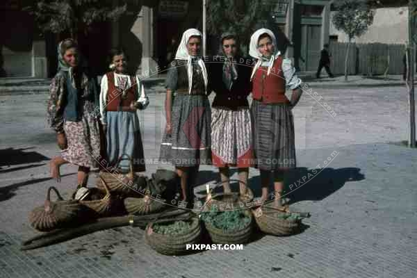 Peasant girls selling grapes on the street in Belgrade, Serbia 1941