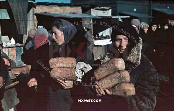 peasant women with loafs at the market, Romania 1942