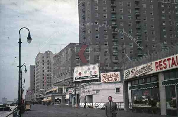 PostW color 1947 New York board walk shop restaurant american flag bank german tourist