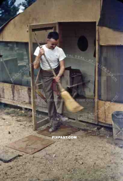 Sweeping in front of the barracks in Okinawa, Japan 1946