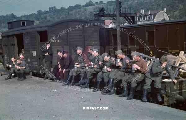 Wehrmacht train station transport Belgium 1940, eating soup in canteen, carriages, Jewish David star on carriage,
