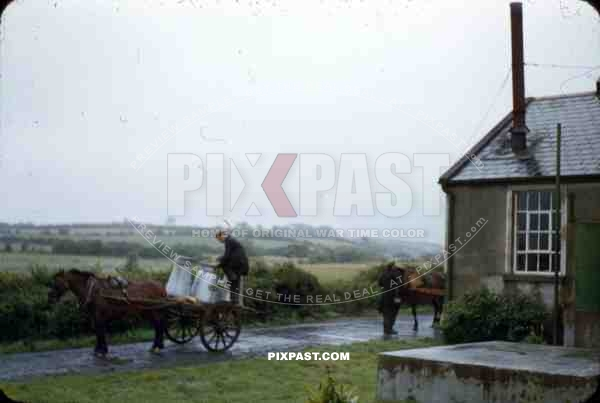Wicklow Gap, Ireland, 1953, American tourist photograph milk delivery to farm house in country side.