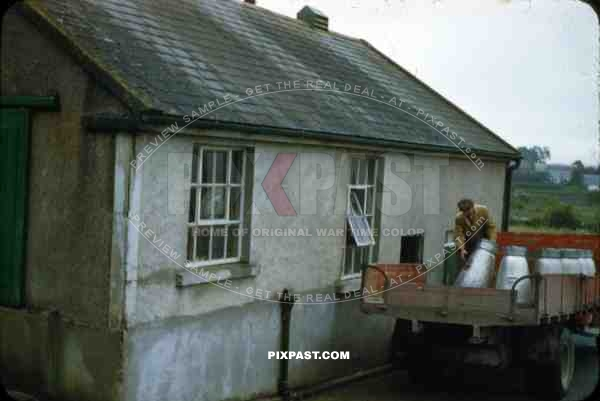 Wicklow Gap Ireland 1953, milk man delivery old Irish cottage, farmer life. red truck,