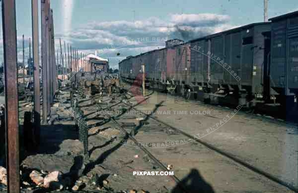 WW2 color Belgium 1945 Bombed German supply Train Station wagons 88mm ammo exploded