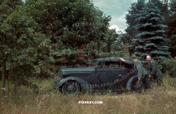 WW2 german officers pushing staff car outside Villa Holland 1940 summer